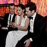 Selena Gomez showed Justin Theroux and Paul Rudd something interesting on her phone during the InStyle event.