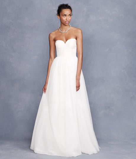 """I love the timelessness of this gown. Its sweetheart neckline and fitted bodice are incredibly feminine but simple — and totally flattering. You know years later looking back at your wedding-day pictures, you'd still think it was just as lovely."" — Hannah Weil, assistant editor J.Crew Tulipe Bustier Gown ($1,800)"