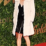 Kate beating the cold at the British Fashion Awards in 2013.