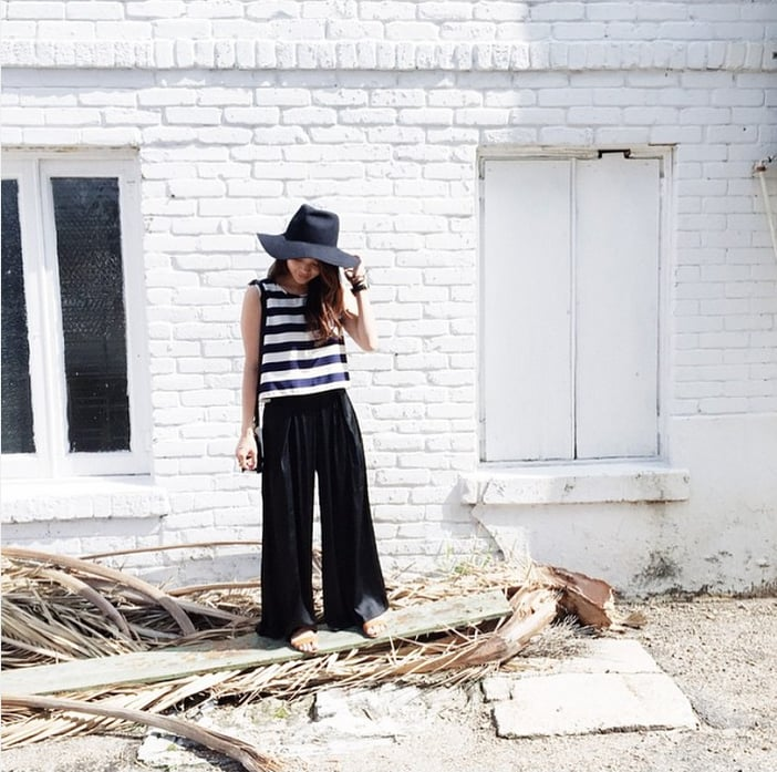 A Striped Tank, Black Wide-Leg Pants, and a Hat