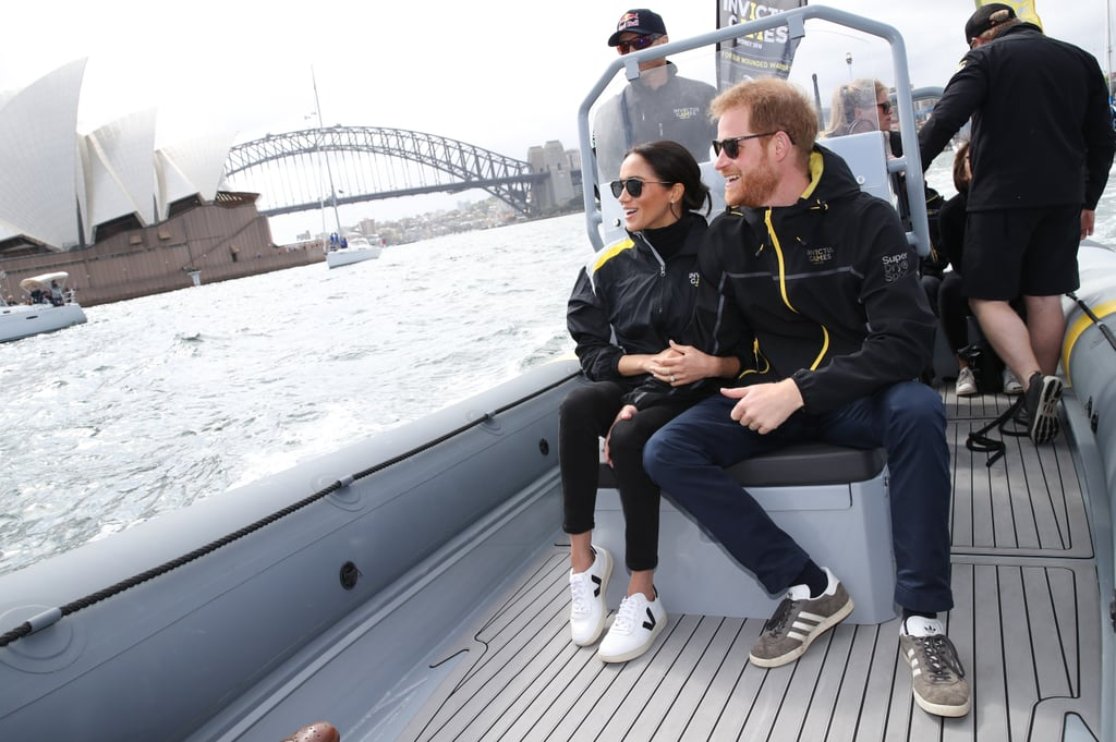 Meghan Markle is in the thick of her 16-day Australia tour with Prince Harry, and we're still dying for a peek inside her travel wardrobe. The Duchess of Sussex stayed in to rest during Sunday morning's events in Australia, but reunited with Harry in the afternoon and served us not one, but two, doses of outfit inspiration. She started off her events for the day in a L'Agence blazer ($550), black jeans, Aquazzura pumps, a turtleneck sweater, and Adina Reyter earrings ($498). When the couple tagged along for a sailing expedition, Meghan swapped her blazer for an Invictus Games jacket, and her pumps for Veja sneakers ($140). Believe it or not, this is actually Meghan's first time wearing sneakers to a royal outing. We know she was a fan of casual trainers before becoming a duchess, and we're so glad to see her break them out again as a royal. Check out more snaps of her weekend casual outfit ahead.      Related:                                                                                                           Meghan Markle's $120 Espadrilles Look Familiar Because Pippa Middleton Has Them Too