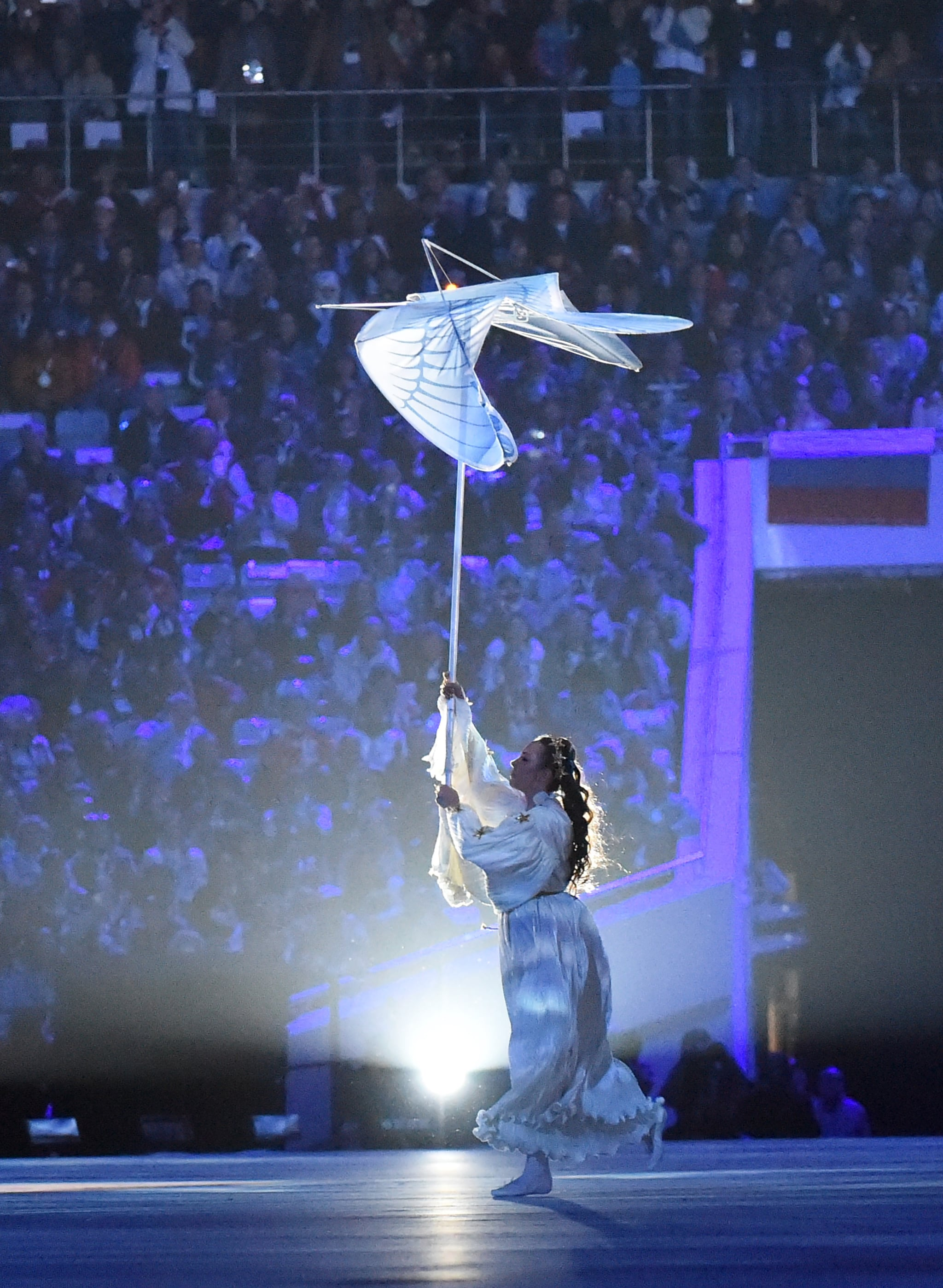 A dancer held up the white bird as she performed.