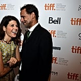Marisa Tomei had a laugh with Alexander Siddig on the red carpet at the Inescapable premiere at the Toronto International Film Festival.