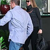 Jennifer Aniston wore a scarf and yoga pants.