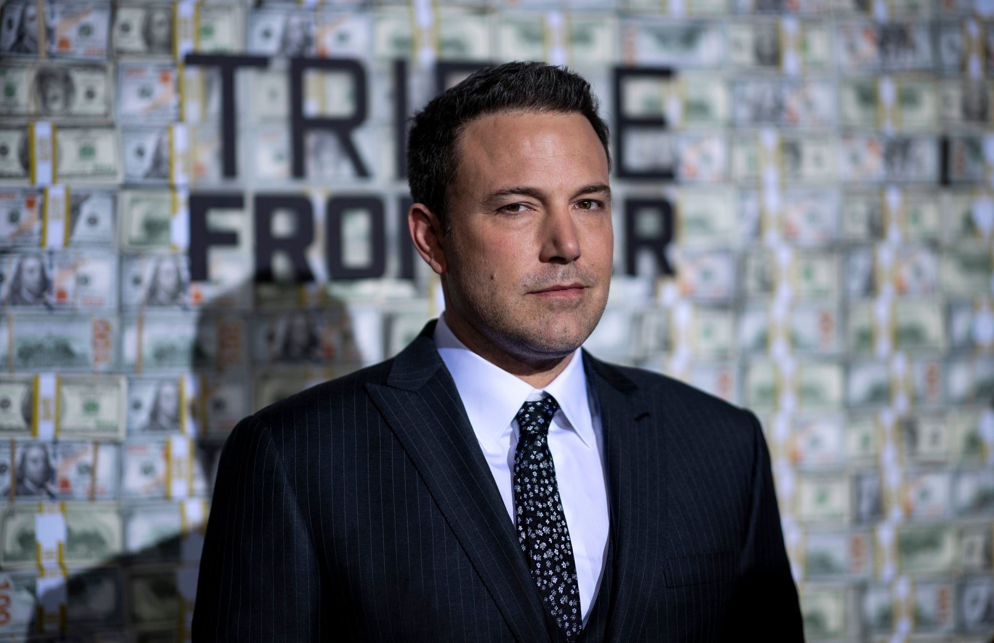 US actor Ben Affleck poses as he arrives for the world premiere of