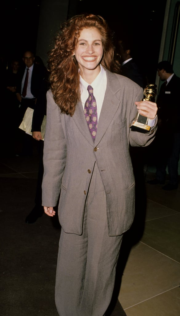 A suit-wearing Julia grinned after winning a Golden Globe in 1990.