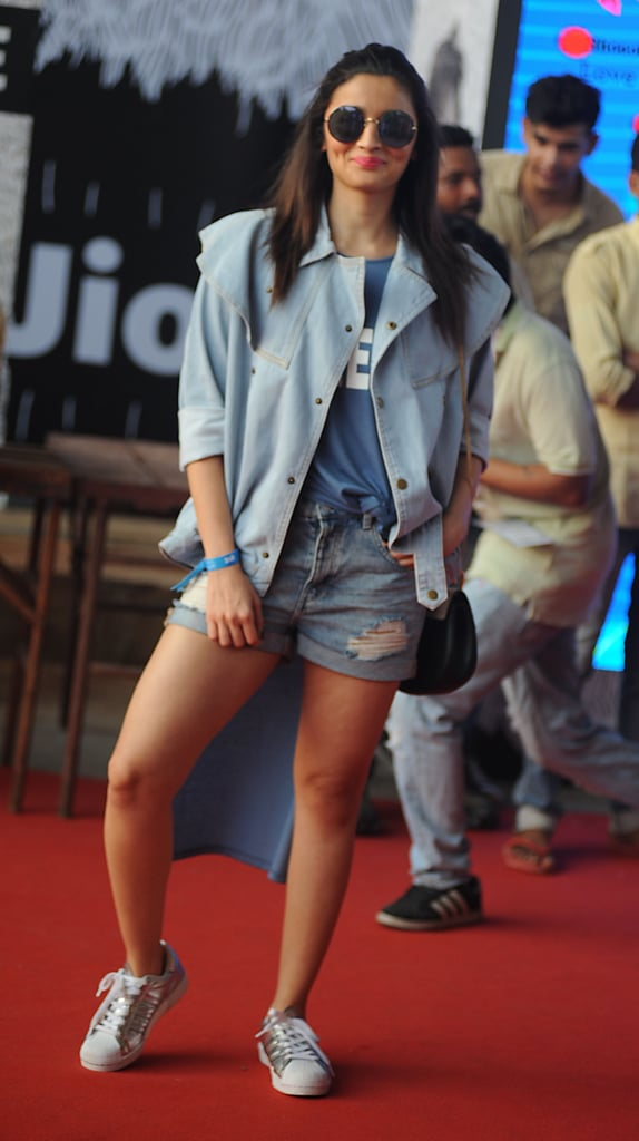 Looking laid-back in a light blue coat and denim cutoffs.