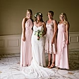 All of these bridesmaids wore different light-pink dresses.