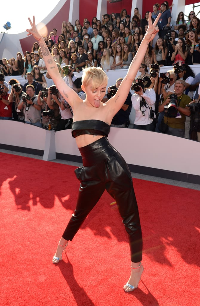 """Miley Cyrus was up to her old tricks when she hit the red carpet at the 2014 MTV VMAs in LA on Sunday night. The singer, who caused worldwide chatter when she performed at the awards show with Robin Thicke last year, won't be making a repeat performance this year, but she did tease on the red carpet that she will be involved with something special during the show. However, there will be no twerking, as she said on the carpet, """"It's not about the twerking, it's about the music."""" Miley is also up for several awards, including video of the year and best direction. Be sure to check out all the red carpet arrivals from the MTV VMAs, and don't forget to tune into our live viewing party!"""