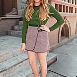 Chloë played with prints in a Kenzo sweater and wrap skirt with sleek ankle-strap sandals.