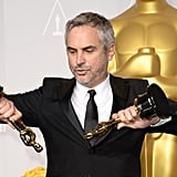 Alfonso Cuarón looked like he was reenacting a scene from Gravity with his two Oscars — one for best director and one for best film editing.
