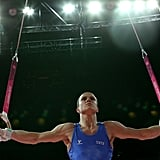Paolo Ottavi of Italy finds his balance on the rings.