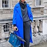 A blue coat and red shoes give this look two strong focal points.