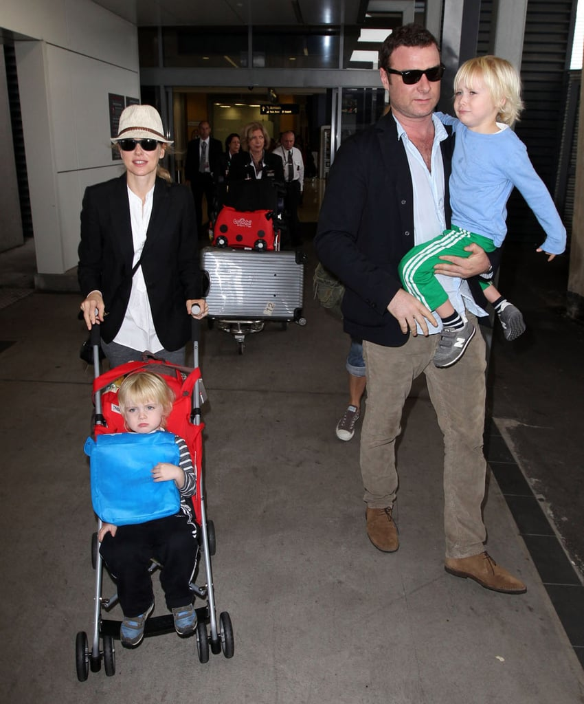 Naomi Watts and Liev Schreiber walked their kids off of a long flight to Sydney.