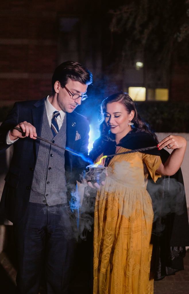 Before they could even see over the counter at Honeydukes, Kat Andrusco and Spencer Howard were best friends who bonded over their love for all things vintage and magical. Years later, the two young wizards became a couple and went on to celebrate their love with a Harry Potter-themed engagement photo shoot inspired by their shared love for the wizarding world.  Kat, a Hufflepuff, and Spencer, a Ravenclaw, decided to promote some Hogwarts inter-house unity by incorporating their house colors into the shoot, which took place at the University of California Los Angeles on Nov. 2, 2019. Making it clear that this was not a muggle engagement, the couple made the shoot a little more magical with the use of wands, flying key earrings, Kat's black cape, Spencer's Ravenclaw broche, a Platform 9 3/4 pin, a mini cauldron, and a copy of Harry Potter and the Goblet of Fire. Most magical of all, Kat and Spencer sent actual sparks flying with the creative use of dry ice and colorful lights to re-create the effect of magic emanating from the tips of their wands, and the result is absolutely stunning. Keep scrolling to see all of their engagement shoot photos, and prepare yourself, because I feel like I need to get an Outstanding on my Charms N.E.W.T. to handle this level of enchantment.       Related:                                                                                                           Each Table at This Harry Potter Wedding Reception Is Based on a Hogwarts House!