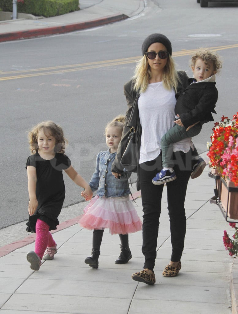 "Nicole Richie stopped to get lunch with her kids Harlow Madden and Sparrow Madden at LA's Cafe Med yesterday. The mom of two spent the afternoon with her little ones following a fun weekend, in which she and husband Joel Madden brought Harlow and Sparrow to pick out their pumpkins at a patch. Nicole evidently had music on while in the car, as she tweeted, ""J Lo's new song just came on the radio, and I immediately thought of the Fiat. . . So I guess that commercial really worked."" Nicole may make a TV spot of her own over the next year, as she'll have her first scent to promote. Nicole Richie's fragrance will be  ""cool and classy with an edge,"" though we won't get to sniff it until next Fall!"