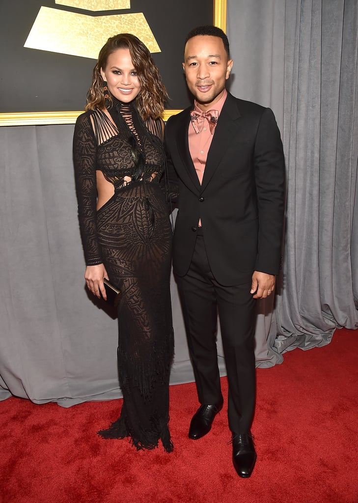 """Award show red carpets better watch out, because John Legend and Chrissy Teigen are on fire. After slaying at the SAG Awards in January, the cute couple arrived to the Grammys on Sunday night looking like prom king and queen. Although Chrissy's jaw-dropping, semisheer black gown was a total showstopper, it was hard to peel our eyes away from the remnants of her Fun Dip-stained fingers. The """"Beauty and the Beast"""" singer, who looked pretty spiffy himself in a pink satin bow tie, had his arm around Chrissy as they made their way down the red carpet in front of photographers. We'll just go ahead and add these to their ever-growing scrapbook of adorable moments, ok?      Related:                                                                Time Out, NYFW: The Grammys Red Carpet Was Buzzing With Style                                                                   John Legend Is """"Proud"""" to Be Married to a Badass Feminist Like Chrissy Teigen"""