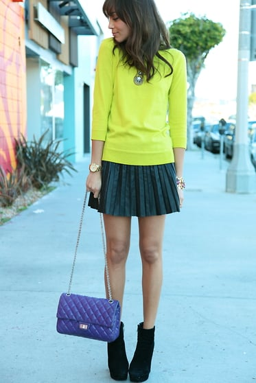 We spotted Ashley Madekwe working the trend with a bright J.Crew sweater and a pop of purple on her bag.  Photo courtesy of Lookbook.nu