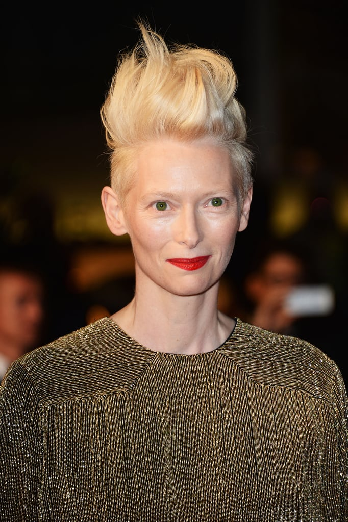At the Only Lovers Left Alive debut, Tilda Swinton took her hairstyle to new heights. Her fire-engine red lipstick matched the edgy style perfectly.