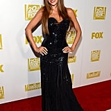Leave it to Sofia Vergara to amp up the sex appeal at the 2013 Golden Globe Awards. Ms. Vergara worked a formfitting black gown with an allover glitter finish and equally dazzling cocktail ring, then completed her red carpet style with shiny sleek strands and a red pout.