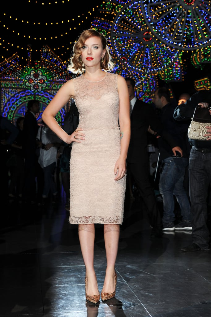 Scarlett Johansson stepped out in a blush colored lace sheath and black onyx earrings by Dolce & Gabbana.