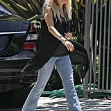 Nicole Richie channeled the boho vibe in a pair of distressed flares.