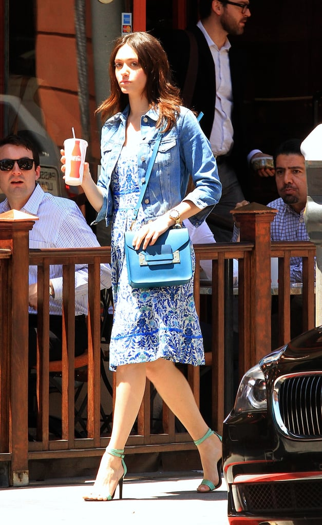 On another occasion, Emmy Rossum gave her Tory Burch Ramona dress ($450) a kick-back air via a denim jacket, then added a blue structured crossbody bag and green ankle-strap sandals for further oomph.  Shop our favorite denim jackets below:
