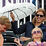 Princess Beatrice brought out her umbrella.