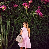 You'll be the focal point of the photo when you throw on a sugar-pink dress and park it in front of a gorgeous flower wall.