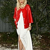 Rita Ora struck a color contrast in bright red, crisp white, and stark black at the Chanel Couture Spring '13 show.