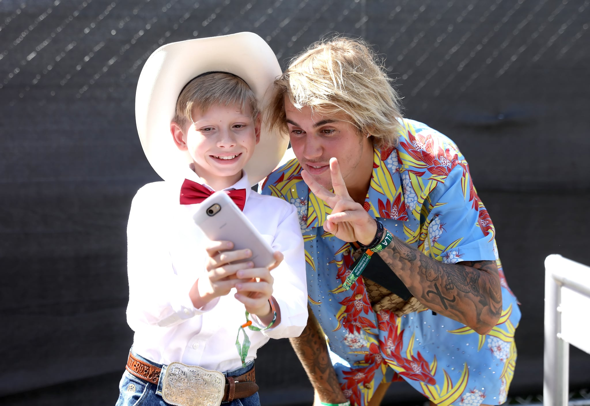 INDIO, CA - APRIL 13:  Viral internet sensation Mason Ramsey aka The Walmart Yodeling Boy, (L) and Recording Artist Justin Bieber pose for a selfie backstage during the 2018 Coachella Valley Music And Arts Festival at the Empire Polo Field on April 13, 2018 in Indio, California.  (Photo by Natt Lim/Getty Images for Coachella)