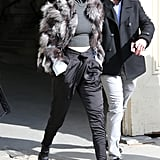 Gigi met her satin trousers with a cropped turtleneck top, finishing off her postrunway outfit with a Waldrip furry coat, Sandro boots, and Krewe du Optic lenses.