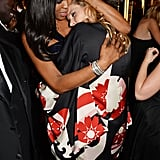 Model BFFs Naomi Campbell and Kate Moss shared a warm embrace at a London event in December 2014.
