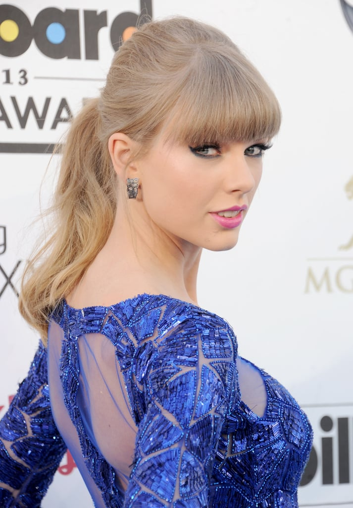 Taking your ponytail up a few inches for a midheight look helps balance out a long face shape like Taylor Swift's, who was at the Billboard Awards.