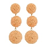 These Kenneth Jay Lane 2 Peach Pink Seed Bead Wrapped Ball Post Earrings w/ Dome Top ($88) make for the perfect beach wedding baubles.