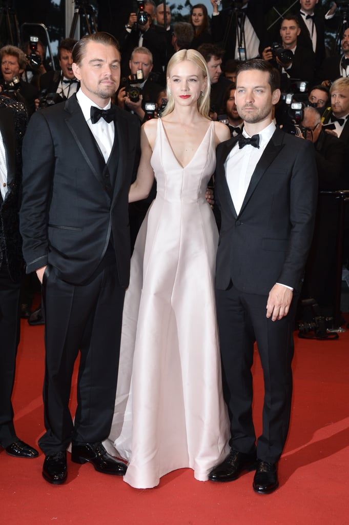 Carey Mulligan posed with her costars Leonardo DiCaprio and Tobey Maguire in a pale pink Dior gown at the Cannes premiere of The Great Gatsby.