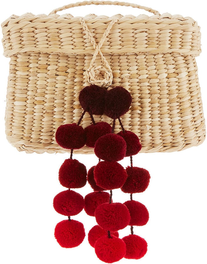 We imagine this Nannacay straw baby roge red pom pom bag ($188) was made for vacation.