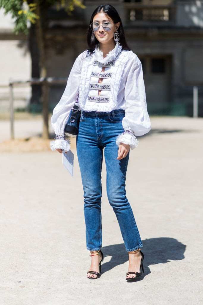 With a romantic blouse and ankle-strap heels