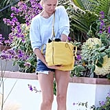 Cameron Diaz toted a yellow bag.