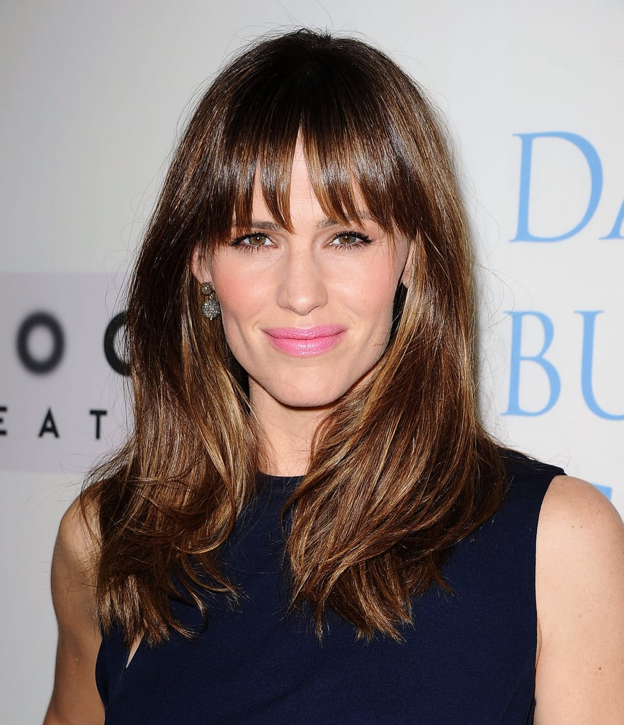 Jennifer Garner paired her shiny blowout with a touch of bubblegum-pink lipstick for a fun pop of color.