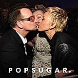 Ellen DeGeneres and Portia de Rossi went in for a three-way kiss with Bono at the Vanity Fair bash.