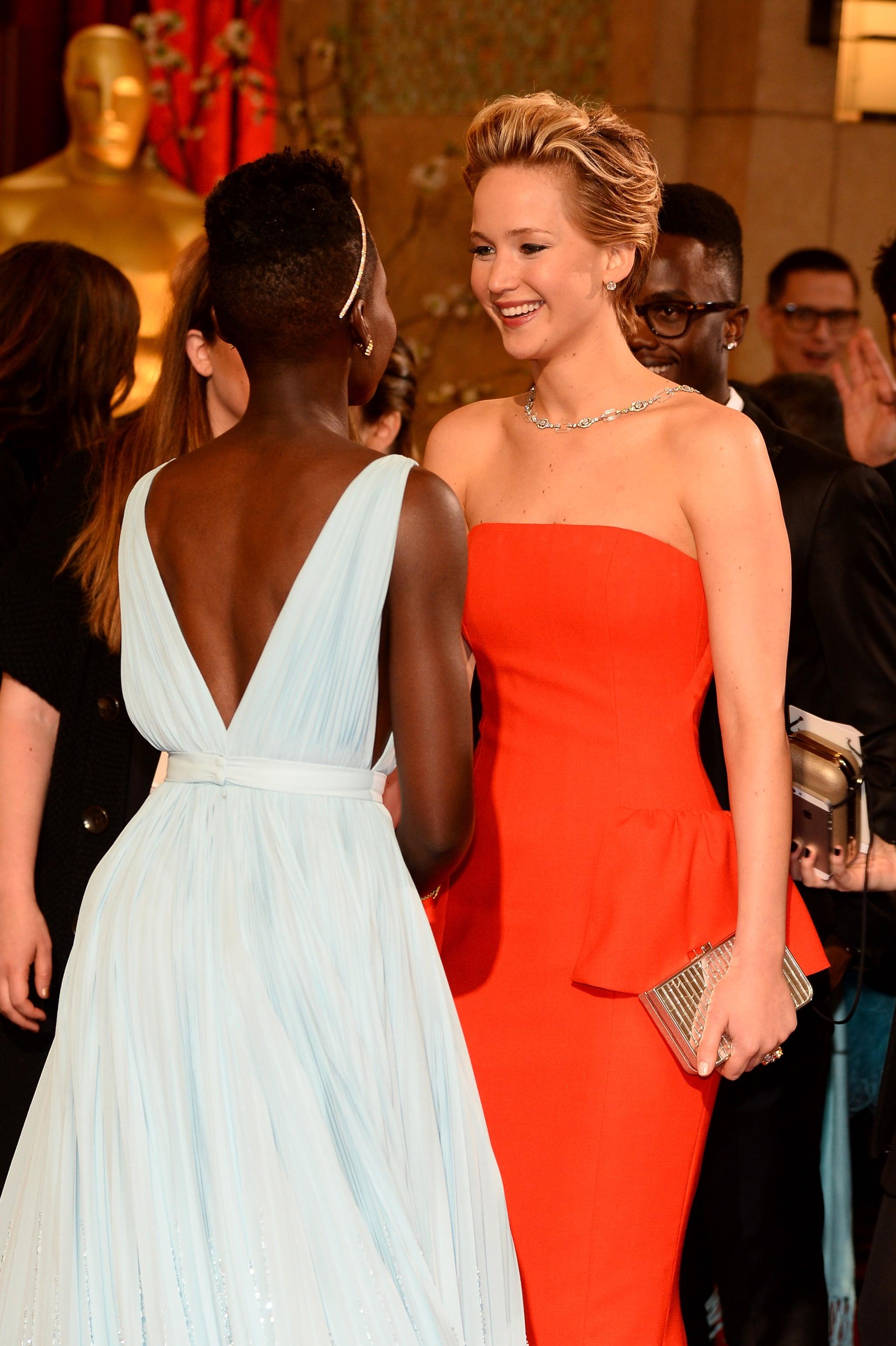 Lupita Nyong'o and Jennifer Lawrence at the 2014 Oscars.
