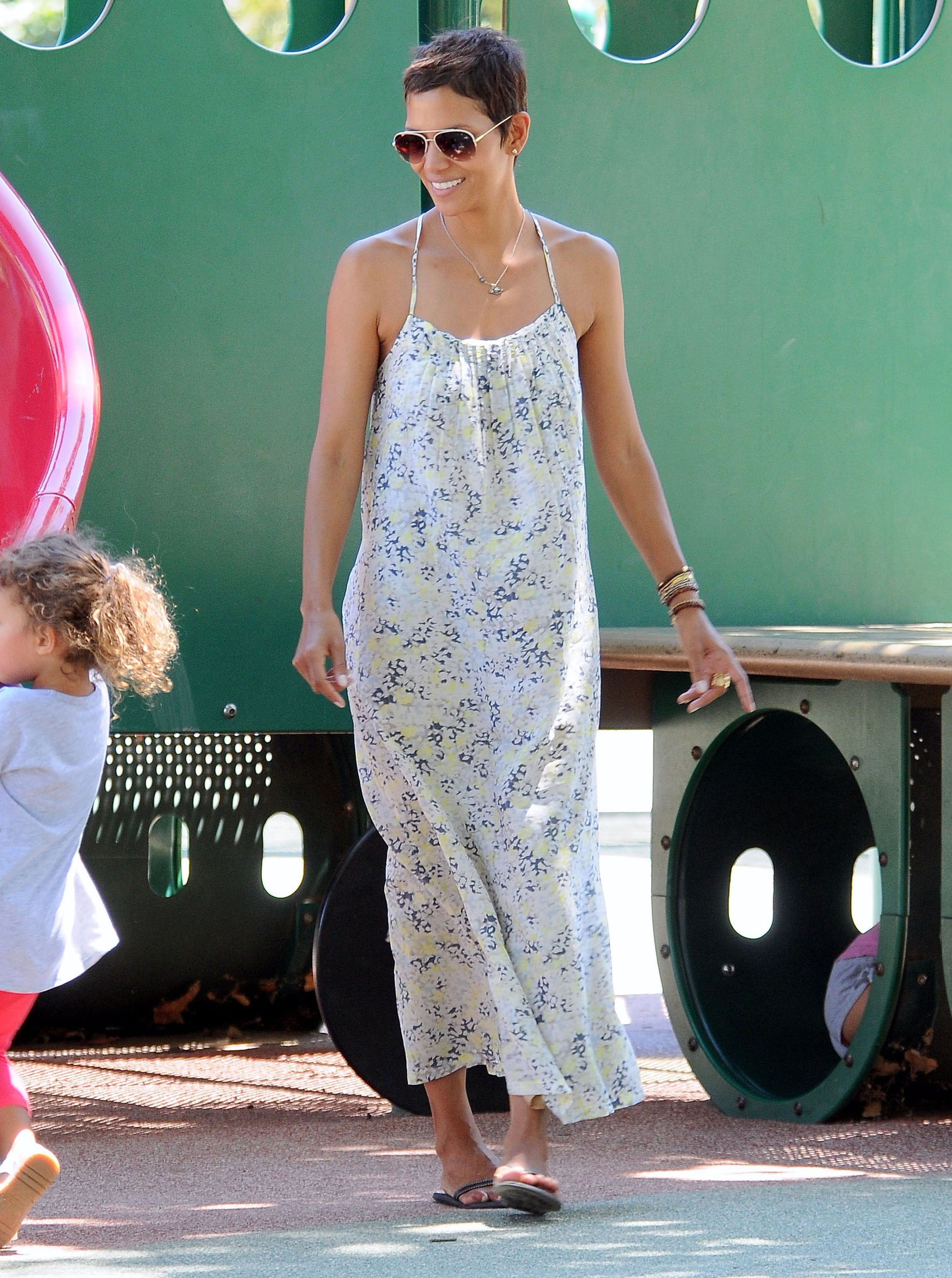 Even though she looks great in body-con silhouettes, she looks even dreamier by day in flowy floral maxi dresses.