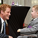 In August, Harry talks with the winner of a national WellChild award, before he presented the awards at a ceremony in London.