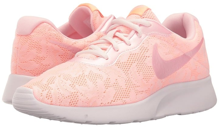 In case you haven't realized, millennial pink is having a moment. Hop on the trend by trying these lace Nike Tanjun ENG Sneakers ($70).