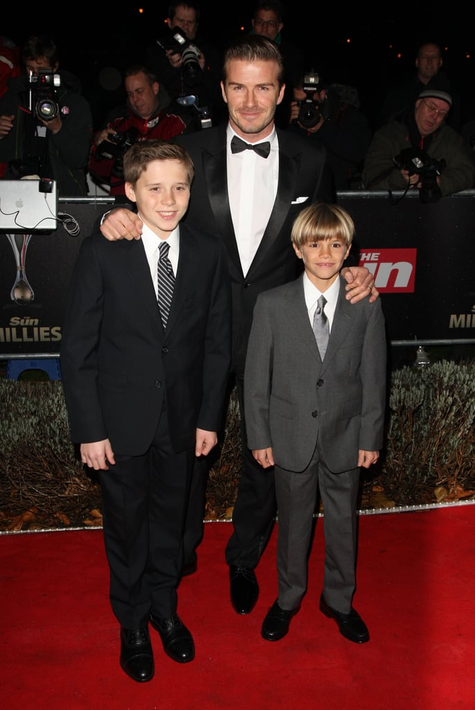 David Beckham posed with his oldest sons, Brooklyn and Romeo, at The Sun's Military Awards in London this evening. The show, which is held at the Imperial War Museum, honors the work of Britain's servicemen and women. David, Brooklyn, and Romeo weren't the only famous faces in attendance since their pals Gordon Ramsay and his wife Tana dressed up for the event, as did a few members of the royal family. Princes William and Harry made an entrance in tuxedos while Kate Middleton stole the spotlight in a black velvet McQueen gown. It was William, Harry, and Kate's second activity of the day, after also sitting down for the Queen's annual pre-Christmas lunch at Buckingham Palace.  The Beckhams arrived in England over the weekend and the family of five plan to spend the holiday in their native country. It's baby Harper's first festive season, and her birth in July was just one of the Beckhams' best moments of 2011.