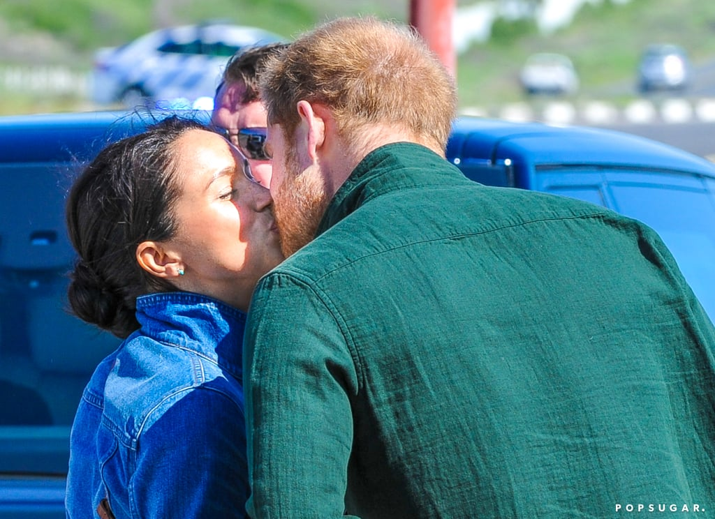 """Despite being royals, Prince Harry and Meghan Markle are just like any other couple (for the most part) and have no problem showing off their love for each other. The pair officially kicked off their 10-day tour of Southern Africa on Monday, and the following day, they snuck in a sweet kiss during a stop at the Waves For Change compound kitchen in Cape Town. As Harry and Meghan wrapped up their visit and Harry headed to a solo engagement, the duo squeezed in a little PDA before heading into different cars.  Of course, this is just one of the many cute moments Harry and Meghan have already shared on the trip. In addition to busting a move in Cape Town's Nyanga Township and meeting several precious kids, Harry and Meghan also gushed about each other's parenting skills. During one of the bonding exercises on the tour, Meghan called Harry """"the best dad,"""" and Harry quickly added that she was """"the best mom."""" Aw!  Harry and Meghan's 4-month-old son, Archie Mountbatten-Windsor, is also on the trip with his parents, marking the trio's first royal tour as a family. However, the tiny tot has been staying behind with his nanny. Hopefully we'll get to see him soon!      Related:                                                                                                           Meghan Markle Kicks Off Royal Tour With an Inspiring Speech About Women's Rights"""