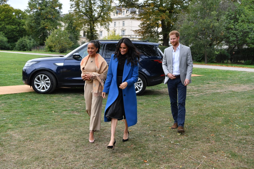 """Meghan Markle hosted a special lunch for the women from the Hubb Community Kitchen at Kensington Palace on Thursday, and one person who couldn't have been any prouder — aside from Prince Harry, of course — was Meghan's mum, Doria Ragland. Doria recently flew out from LA to be by Meghan's side for the royal affair, and while there, she welcomed guests, saying, """"Hi, I'm Meg's mum."""" Aw!  And things only got sweeter from there! After the chair of Penguin Random House, Baroness Gail Rebuck, told Doria she must feel """"very proud"""" of her daughter and her work on the Together: Our Community Cookbook, she replied, """"Head over heels."""" Oh, and if you're wondering what Doria's favourite dish is, she loves the green rice. """"I love that,"""" Doria said. """"That was the first thing I asked about."""" Doria then went on to gush about the cookbook and told the women how excited she is for its release. """"It's amazing. I'm just as excited as you are,"""" she said. """"The power of women. We make things happen. We're curious, we say yes, we show up. I'm inspired."""" You can pr-eorder your copy of Together: Our Community Cookbook on Amazon now.      Related:                                                                                                           7 Photos of Meghan Markle and Her Mum That Prove They're 2 Peas in a Pod"""