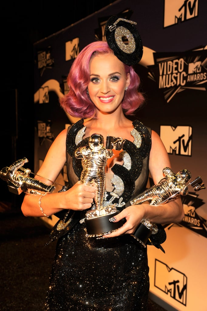 In 2011, Katy Perry showed off her many awards in the press room.