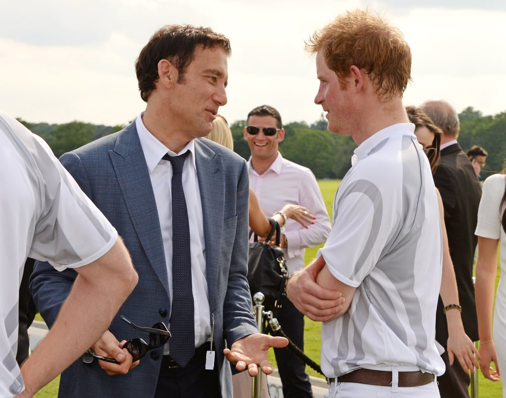 Clive Owen and Prince Harry chatted at the Audi Polo Challenge in Ascot, England in June 2014.